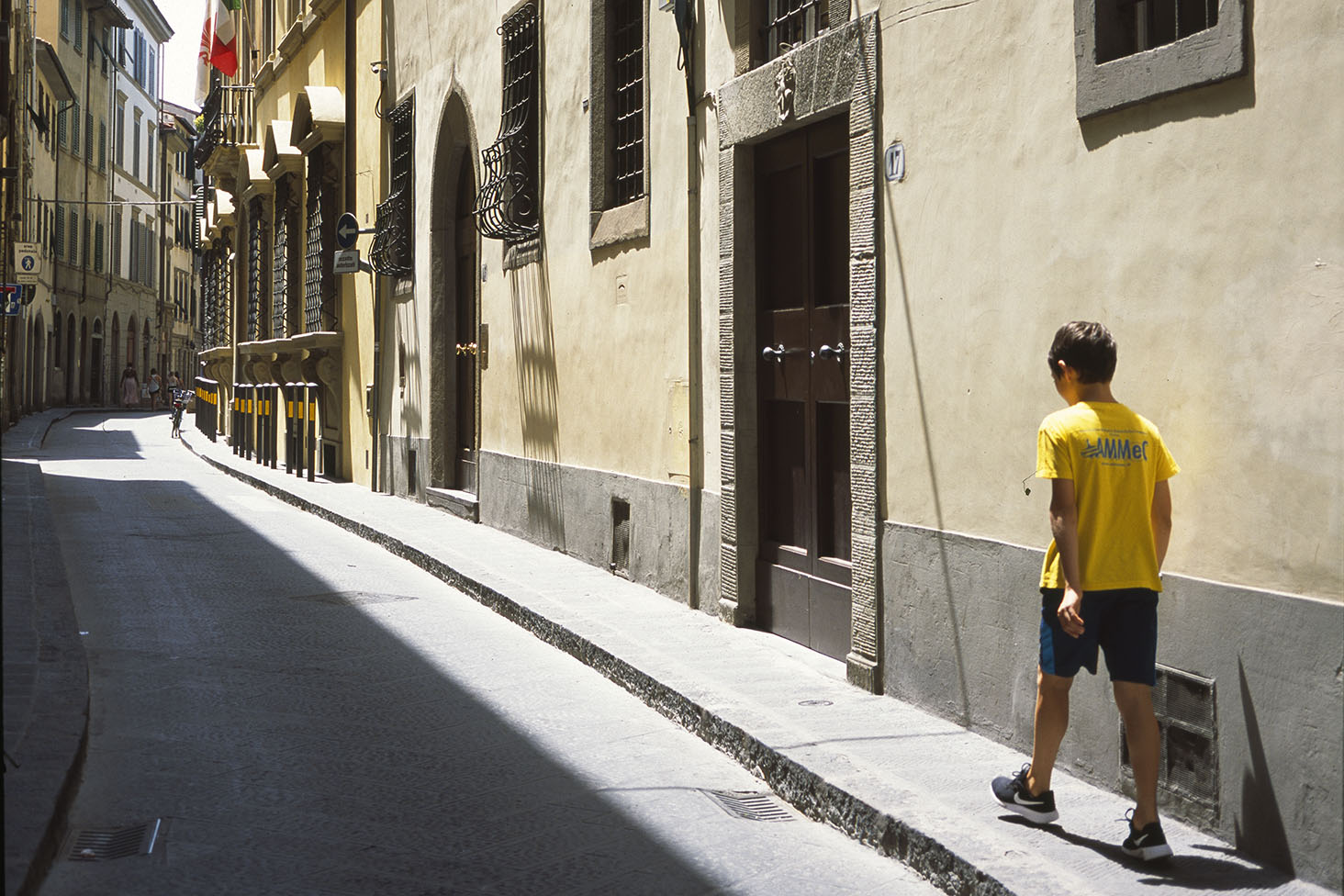 A picture of a boy walking in the streets of Florence
