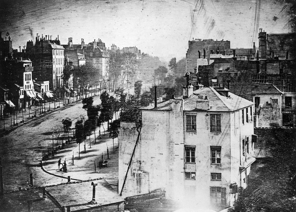 Long Exposure: The First Man that appear in a photograph: Image from Daguerre 1839